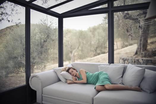Woman Sleeping On Sofa With Throw Pillows Free Photo