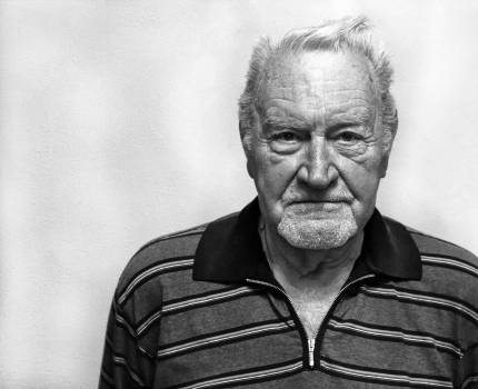 Grayscale Photography of Man Wearing Polo Shirt Free Photo