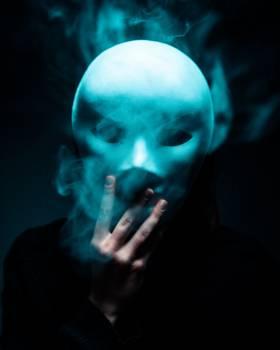 Photo of Person Holding White Mask Free Photo