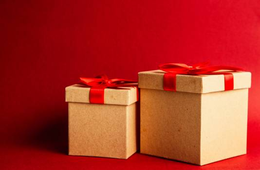 Two Brown-and-red Gift Boxes on Red Surface Free Photo