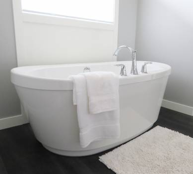 White Ceramic Bathtub Near Window Free Photo