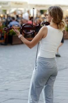 Woman Playing a Violin Free Photo