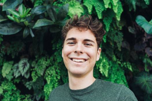 Smiling Man in Front of Green Plants #334582