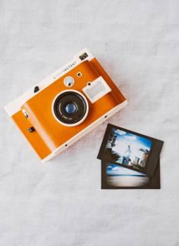 Orange and White Instant Camera on White Cloth #334688