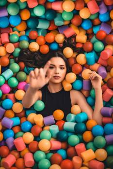 Woman on Plastic Balls Free Photo