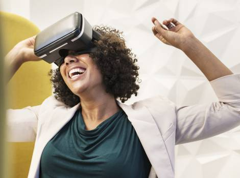 Woman Smiling Using Vr Goggles Free Photo