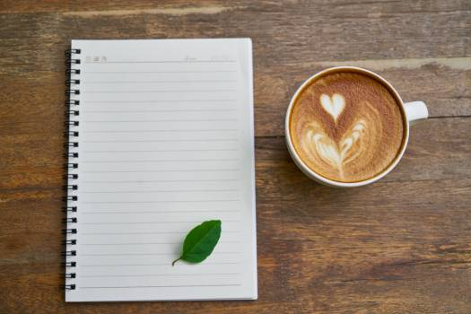 Cappuccino Coffee Beside the Notebook Free Photo