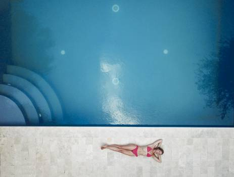 Woman Lying on Floor Near Pool Free Photo