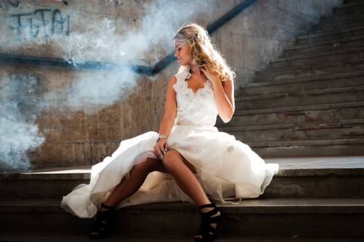 Woman in White Sleeveless Gown Sitting on Staircase Free Photo