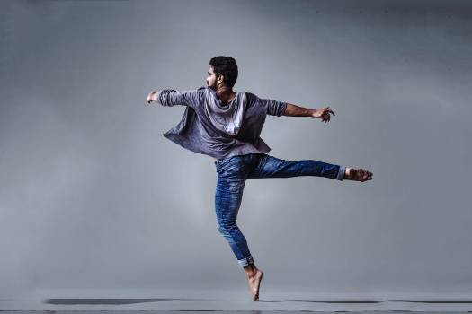 Man Wearing Blue Jeans Doing Pirouette Spin Free Photo