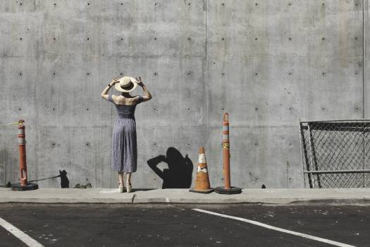 Female in Gray Dress Near Road Cone Staring at Wall Concrete Wall #33536
