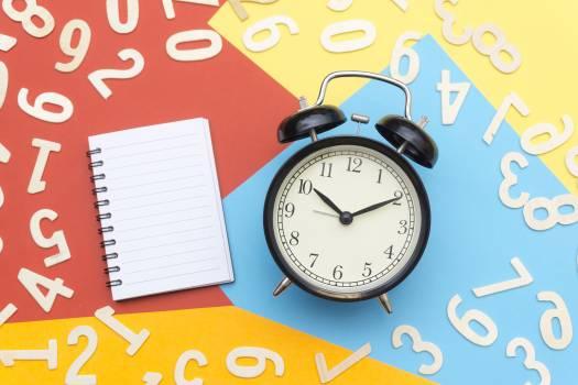 Alarm Clock Lying on Multicolored Surface #335404