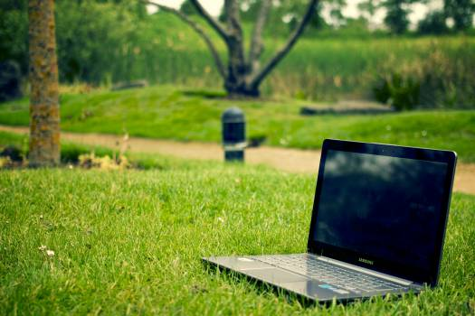 Gray and Black Laptop Computer on Grass Lawn Outdoors #335520