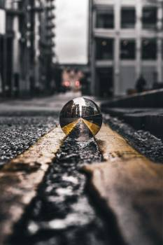 Selective Focus Photo of Lensball On Asphalt Road Free Photo