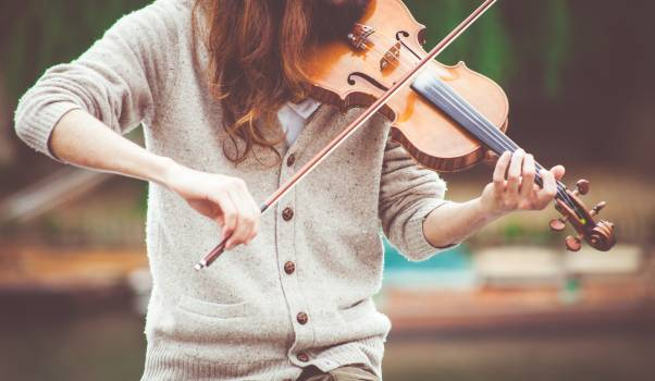 Woman in Gray Cardigan Playing a Violin during Daytime #33571