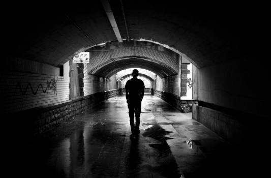 Silhouette Photo of a Man in a Tunnel Free Photo