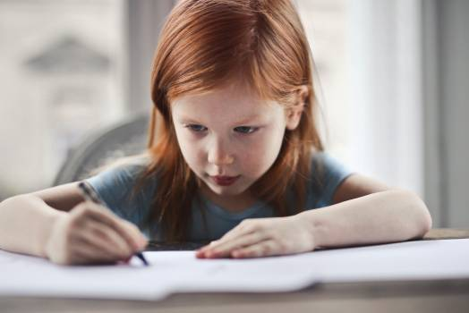 Girl Writing on Paper #336051