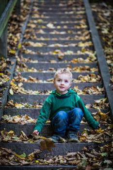 Boy Sitting On Stairs #336131