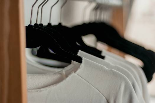Hanged White Shirts on Black Clothes Hangers Free Photo