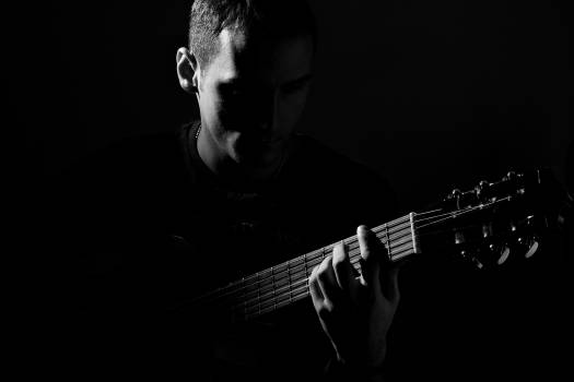 Grayscale Photo of Man Playing Guitar #336237