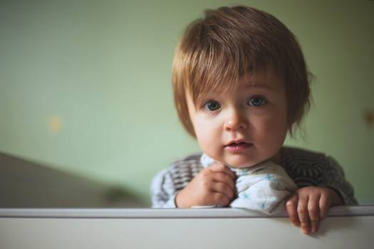 Toddler's Leaning on White Wall #336261