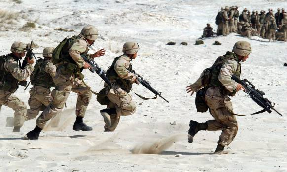 5 Soldiers Holding Rifle Running on White Sand during Daytime Free Photo