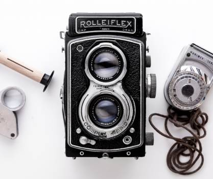 Black Rolleiflex Camera on White Surface #336385