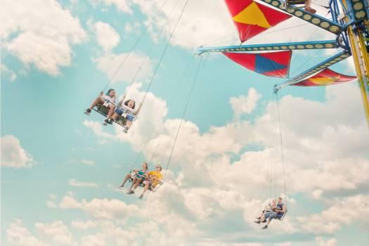 Six Persons Riding Amusement Ride Free Photo