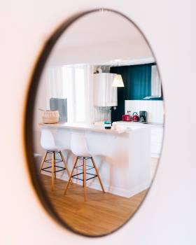 White Wooden Table and Chairs Seen from Oval Mirror #336492