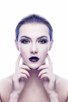 Woman With Purple Lipstick Touching Own Face Free Photo