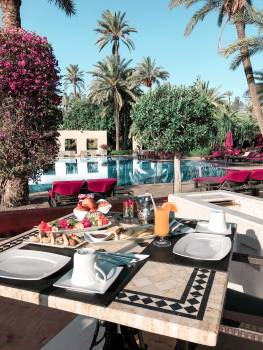 Foods Set on Table by the Pool Free Photo