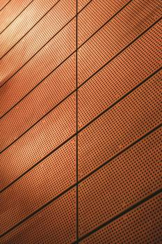 Brown Wall Designed With Holes #336615
