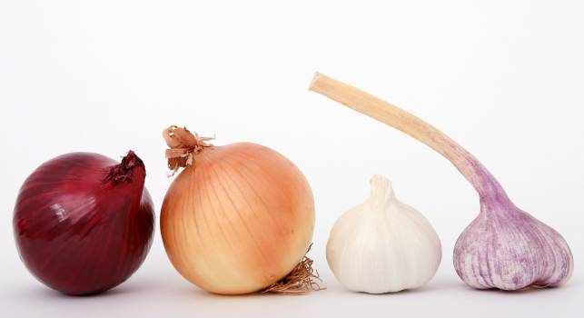 Red Brown White and Purple Onions And Garlic Displayed #336876