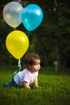 Baby Wearing White Shirt Tied With Three Balloons Free Photo