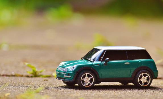 Green Scale Model Car on Brown Pavement Free Photo