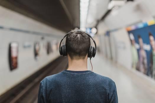 Man Wearing Black Headphones Beside Train Rail Free Photo