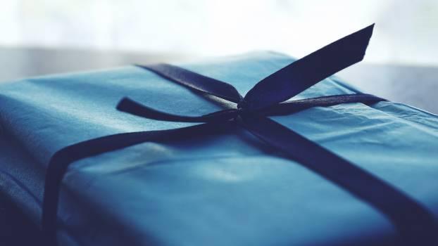Close-up Photo of Tied Blue Box Free Photo
