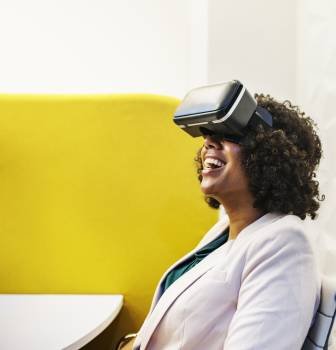 Smiling Woman Using Virtual Reality Headset #337256