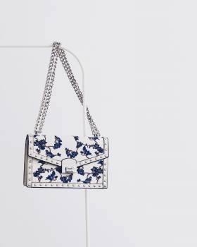 White and Blue Floral Flap Sling Bag Hanging on White Steel Rack Free Photo