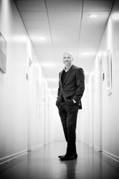 Full Length Portrait of Man Standing in Corridor Free Photo