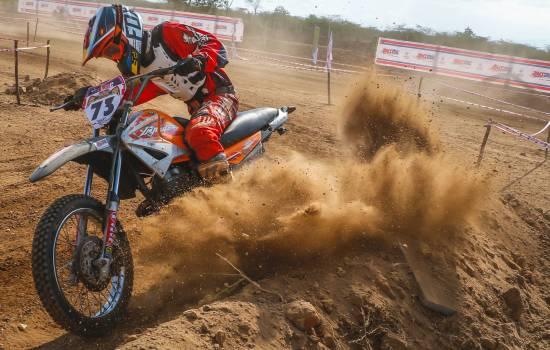 Man Riding Motocross Dirt Bike on Dirt Road Free Photo