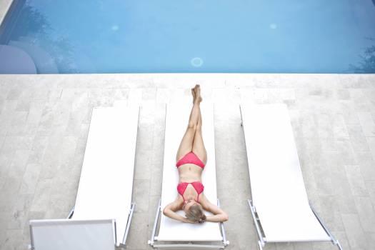 Woman Lying on White Sun Lounger Free Photo