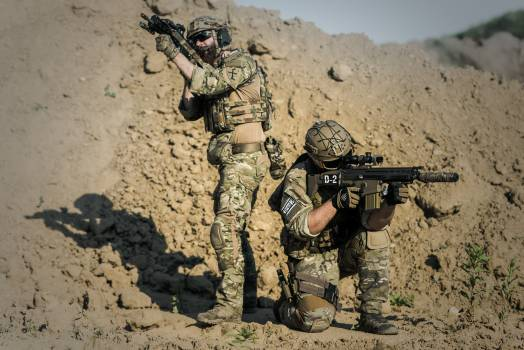 Two Men in Army Uniforms With Guns #337709