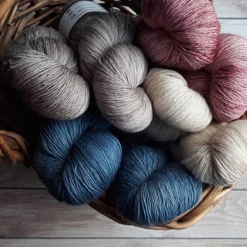 Assorted-color Yarns on Brown Wicker Basket #337739