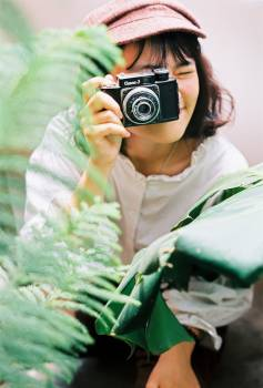 Woman Holding A Camera Free Photo