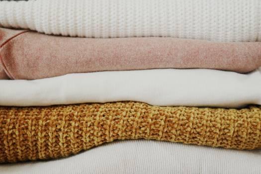 Piled of Folded Textiles Free Photo