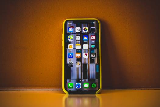 Turned on Iphone X With Yellow Case #337900