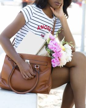 Woman Wearing White and Black Striped Shirt and Brown Leather Handbag #338005