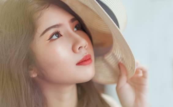 Woman Holding White Hat Free Photo