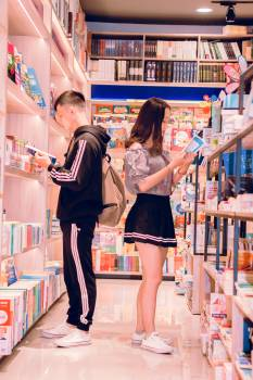 Man and Woman Reading Books Free Photo
